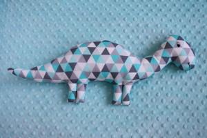 Dinozaur szaro-turkusowe trójkąty